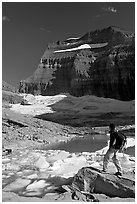Hiker with backpack surveying Grinnell Glacier. Glacier National Park, Montana, USA. (black and white)