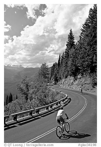 Bicyclists riding down Going-to-the-Sun road. Glacier National Park, Montana, USA.