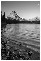 Two Medicine lakeshore with Sinopah Mountain and moon. Glacier National Park ( black and white)
