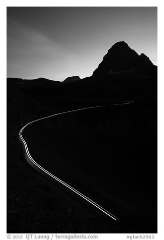 Going-to-the-Sun road at dusk with car light trail. Glacier National Park (black and white)