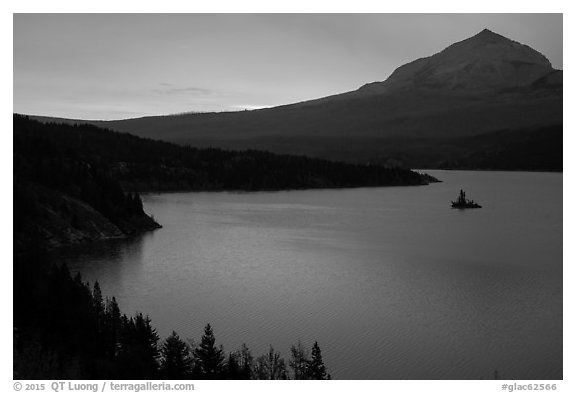 Saint Mary Lake and Wild Goose Island with colors of sunrise in clouds. Glacier National Park (black and white)