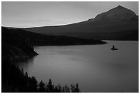 Saint Mary Lake and Wild Goose Island with colors of sunrise in clouds. Glacier National Park ( black and white)