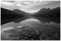 Submerged rocks and mountain reflected, Bowman Lake. Glacier National Park ( black and white)
