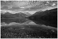 Shoreline with pebbles and mountains with reflections, Kintla Lake. Glacier National Park ( black and white)