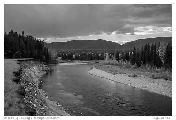 Dark clouds over North Fork of Flathead River in autumn. Glacier National Park (black and white)