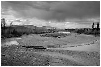 Storm clouds over wide stretch of North Fork of Flathead River. Glacier National Park ( black and white)