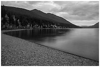 Gravel beach in autumn, Lake McDonald. Glacier National Park ( black and white)
