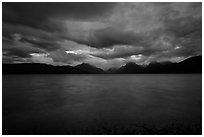 Ominous atmosphere on Lake McDonald at dawn. Glacier National Park ( black and white)
