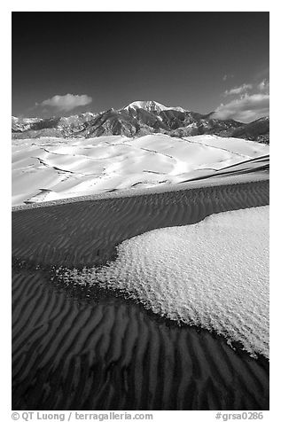 Sand dunes with snow patches. Great Sand Dunes National Park, Colorado, USA.