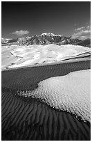 Sand dunes with snow patches. Great Sand Dunes National Park, Colorado, USA. (black and white)