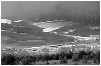 Storm light illuminates portions of the dune field. Great Sand Dunes National Park, Colorado, USA. (black and white)