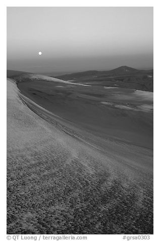 Dunes at dawn with snow and moon. Great Sand Dunes National Park and Preserve (black and white)