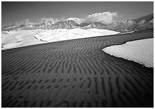 Ripples in partly snow-covered sand dunes. Great Sand Dunes National Park, Colorado, USA. (black and white)