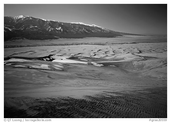 Sand dunes with patches of snow seen from above. Great Sand Dunes National Park and Preserve (black and white)