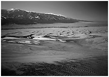 Sand dunes with patches of snow seen from above. Great Sand Dunes National Park, Colorado, USA. (black and white)