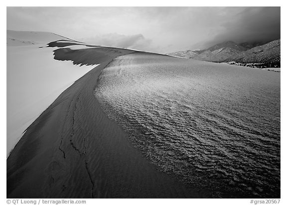 Zig-zag pattern of sand amongst Snow on the dunes. Great Sand Dunes National Park and Preserve (black and white)