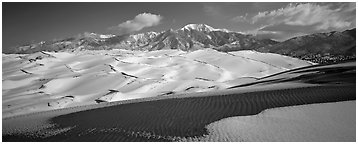 Landscape of snowy dunes and mountains. Great Sand Dunes National Park (Panoramic black and white)