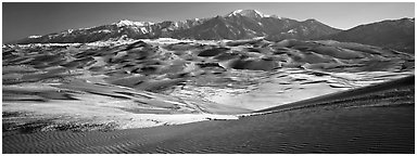 Landscape of sand dunes and mountains in winter. Great Sand Dunes National Park (Panoramic black and white)