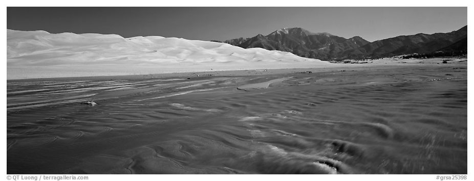 Wide shallow creek at the base of dune field. Great Sand Dunes National Park and Preserve (black and white)