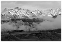 Snowy Sangre de Cristo Mountains and clouds above dune field. Great Sand Dunes National Park, Colorado, USA. (black and white)