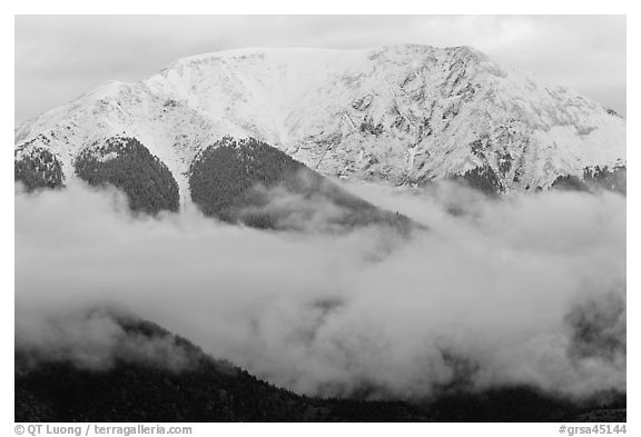 Snowy Sangre de Cristo Mountains above clouds. Great Sand Dunes National Park and Preserve (black and white)