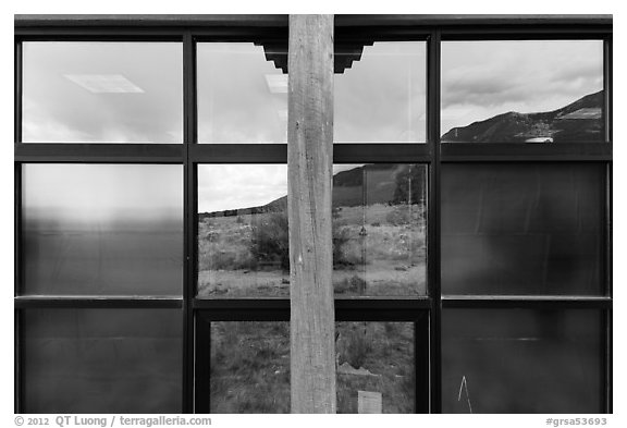 Grasslands and mountains, visitor center window reflexion. Great Sand Dunes National Park and Preserve (black and white)