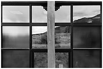 Grasslands and mountains, visitor center window reflexion. Great Sand Dunes National Park, Colorado, USA. (black and white)