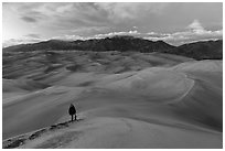 Hiker climbing high dune. Great Sand Dunes National Park, Colorado, USA. (black and white)