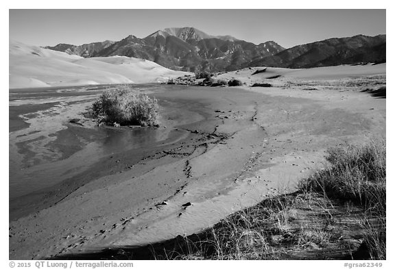 Banks of flowing Medano Creek, dunes and mountains. Great Sand Dunes National Park and Preserve (black and white)