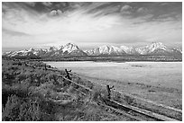 Fence and Teton range in fall. Grand Teton National Park, Wyoming, USA. (black and white)