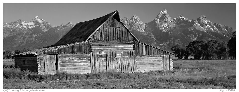 Wooden barn and mountain range. Grand Teton National Park (black and white)