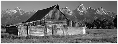 Wooden barn and mountain range. Grand Teton National Park (Panoramic black and white)