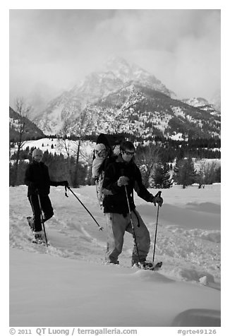Couple snowshowing with baby. Grand Teton National Park (black and white)