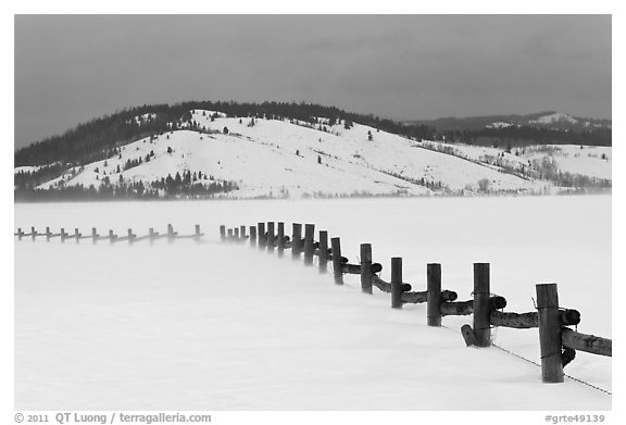 Fence, snowdrift and Ulh Hill. Grand Teton National Park (black and white)