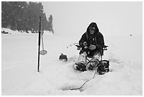 Ice fisherman in white-out, Jackson Lake. Grand Teton National Park ( black and white)
