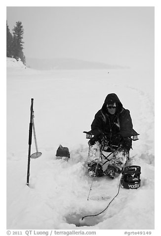 Ice fisherman with lounge chair and radar,Jackson Lake. Grand Teton National Park (black and white)