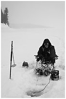 Ice fisherman with lounge chair and radar,Jackson Lake. Grand Teton National Park ( black and white)