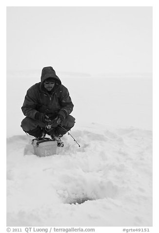 Ice fishing during a snow storm, Jackson Lake. Grand Teton National Park (black and white)
