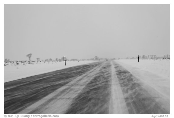 Road with snowdrift in winter. Grand Teton National Park, Wyoming, USA.