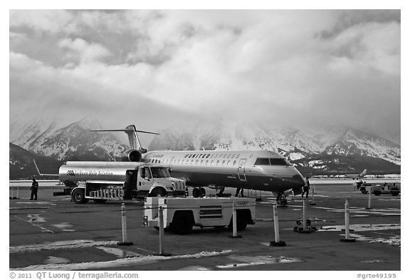 Regional jet and fuel truck, Jackson Hole Airport. Grand Teton National Park (black and white)