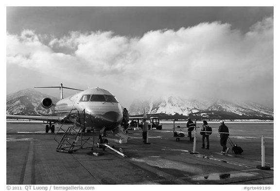 Passengers boarding aircraft, Jackson Hole Airport, winter. Grand Teton National Park (black and white)