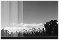 Teton Range, Craig Thomas Discovery and Visitor Center window reflexion. Grand Teton National Park ( black and white)