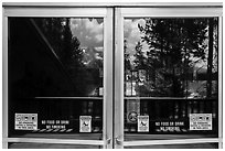 Jackson Lake and Tetons, Colter Bay Visitor Center window reflexion. Grand Teton National Park ( black and white)