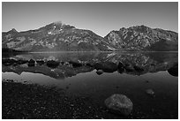 Teton Range reflected in Jenny Lake at sunrise. Grand Teton National Park ( black and white)