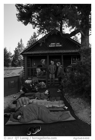Outdoorsmen camping out in front of Jenny Lake Ranger Station for permits. Grand Teton National Park (black and white)