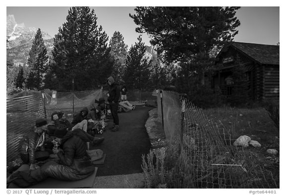 Hikers and climbers camped out in front of Jenny Lake Ranger Station for permits. Grand Teton National Park (black and white)