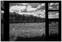 Tetons seen from inside Laurence S. Rockefeller Preserve visitor center. Grand Teton National Park ( black and white)