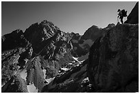 Mountaineer stands on rock looking at peaks, Garnet Canyon. Grand Teton National Park ( black and white)