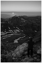 Mountaineer photographs sunset from Lower Saddle. Grand Teton National Park ( black and white)