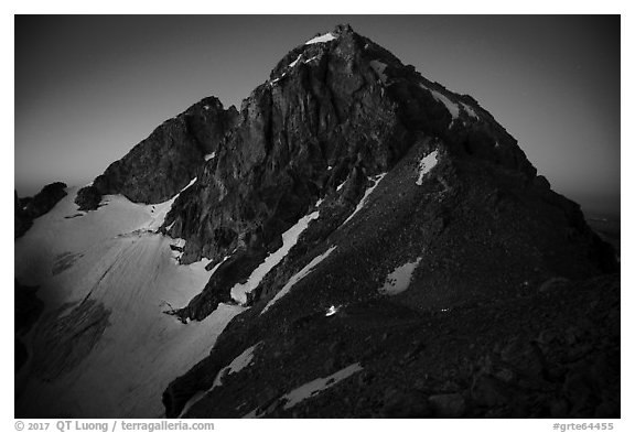 Middle Teton at night, with lights from climbers approaching. Grand Teton National Park (black and white)